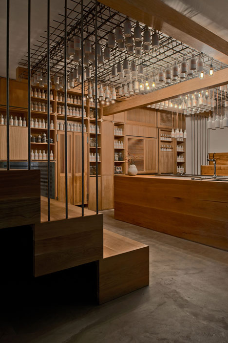 Buero-Wagner-suspends-bottles-of-foraged-ingredients-from-ceiling-of-cocktail-bar_dezeen_3