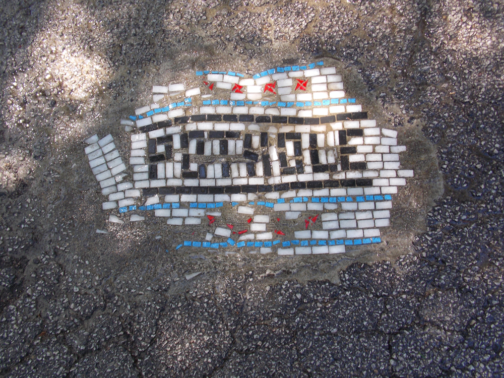 Chicago Artist Mends Potholes with Mosaics potholes mosaics Chicago